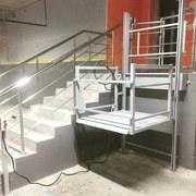 Лифты,  подъёмники,  эскалаторы.